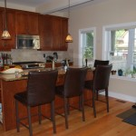 The kitchen has big windows and lots of natural light